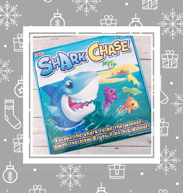 Board game box showing a cartoon shark chasing different sea creatures
