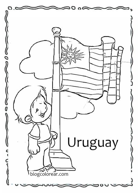 niño izando la bandera de Uruguay ondeante
