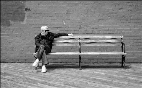 Rebellious old man sitting on a bench picture