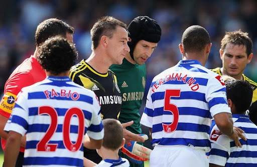 QPR's Anton Ferdinand walks past John Terry of Chelsea during the pre-match handshakes