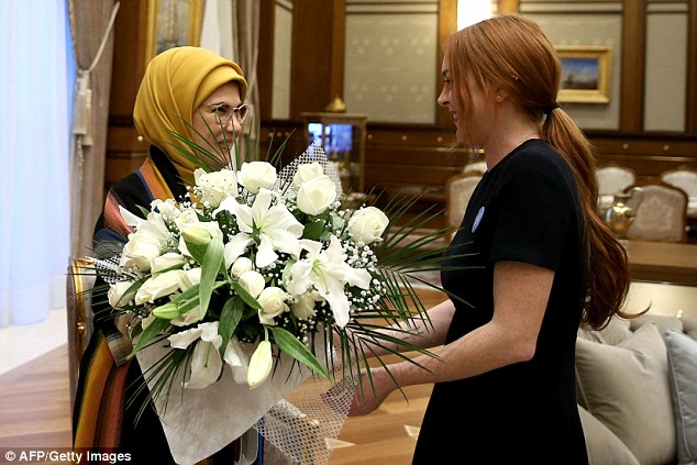 The Turkish President's wife Emine Erdogan welcomes Lindsay Lohan to the presidential palace in Ankara with a bouquet of flowers