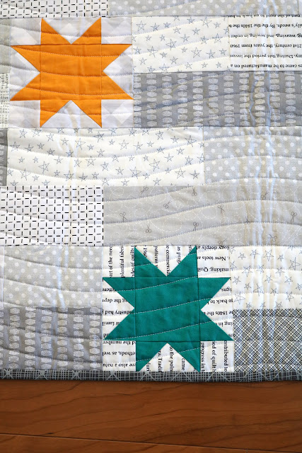 Stellar quilt pattern found in the Fresh Fat Quarter Quilts book by Andy Knowlton of A Bright Corner - a modern lap quilt with a low volume background and bright star blocks