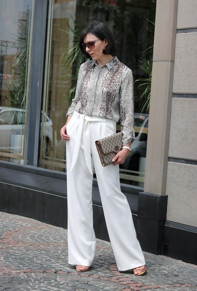 Szerokie biała spodnie damskie stylizacje