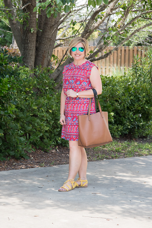 print dress with yellow sandals