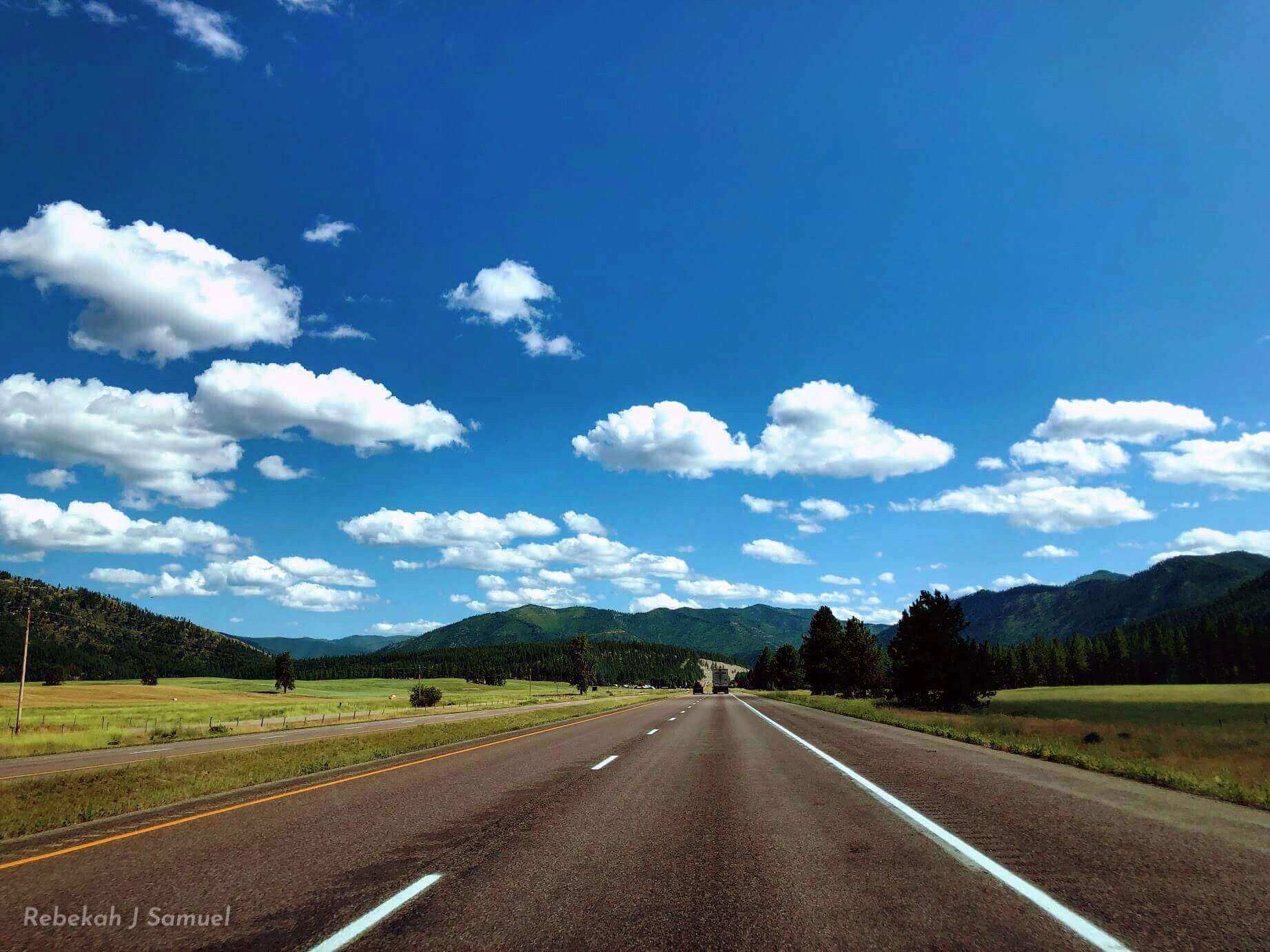 Montana Road, Blue Sky, and Mountains