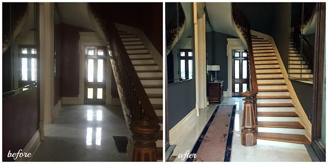 foyer with curved staircase and marble in historic home in Indiana