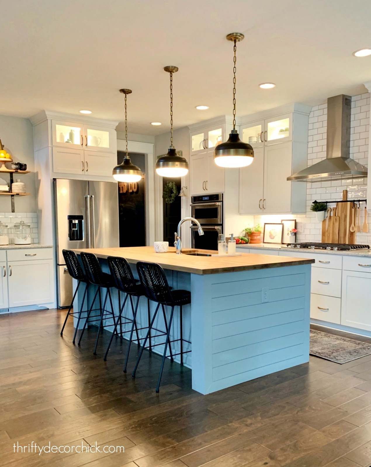 white kitchen black and brass accents