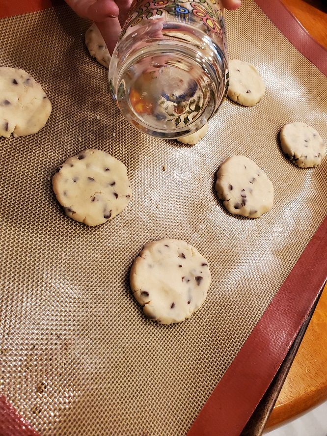 this is raw shortbread cookies with chocolate chips on a silpat mat