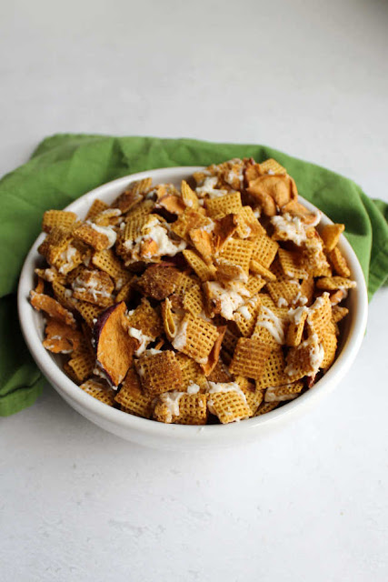 serving bowl with apple spice snack mix ready to eat