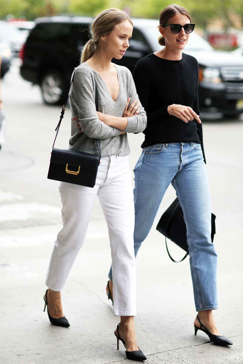 2 Denim Outfit Ideas for Spring - Elin Kling in a gray top, white jeans, and black sling back heels — black top, vintage Levi's jeans, and heels