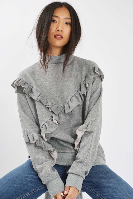 grey frilly jumper