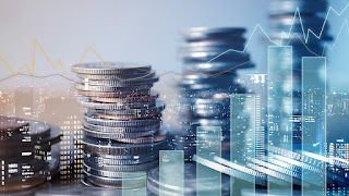 stacks of coins with buildings and microfinance statistics