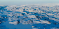 Aerial view of the vast Greenland ice sheets that are melting at an alarming rate. (Image Credit: UN Photo/Mark Garten via Flickr) Click to Enlarge.