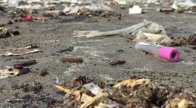 Hospital waste is washed away by Clifton Beach.