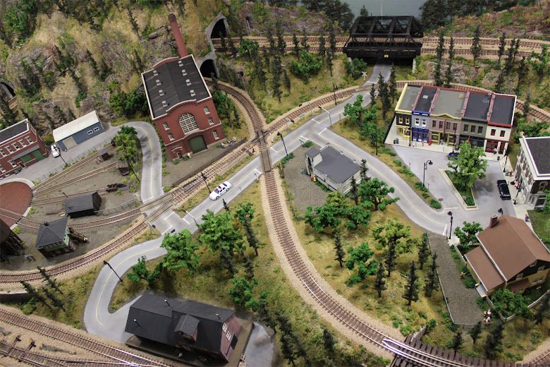An areal view of Ty's 4 x 8 HO scale model railroad layout showing all completed scenery and track