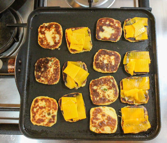 Food Lust People Love: These easy appetizers are perfect for cocktail time and plenty filling for your tapas party. Made with extra sharp cheddar and herby mashed potatoes, potato cake grilled cheese nibbles go down a treat.
