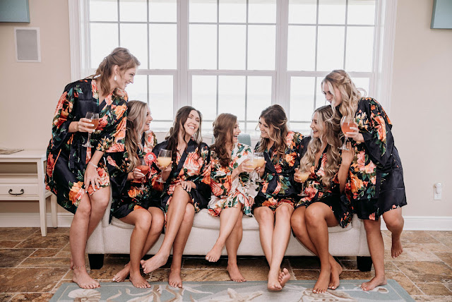bride and bridesmaids in robes on wedding morning