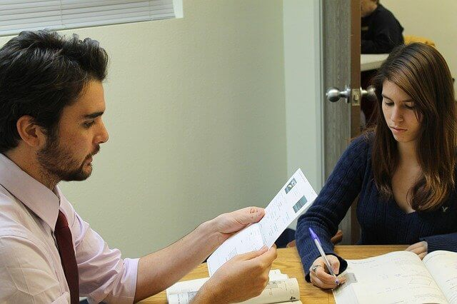 A dialogue between a teacher and a student about home work.