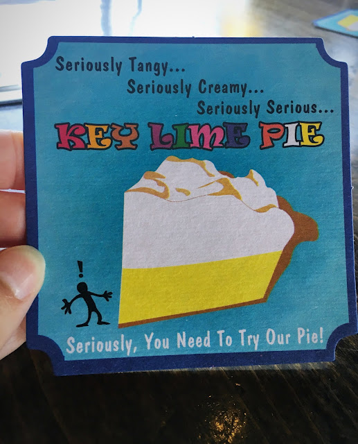 Coaster with an ad for Sundowners' Key Lime Pie.