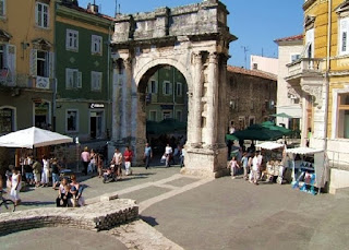 Pula in Sardinia has many Roman ruins such as this arch in the centre of the town