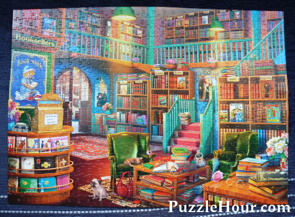 The corner bookstore jigsaw puzzle completed buffalo games colourful books theme