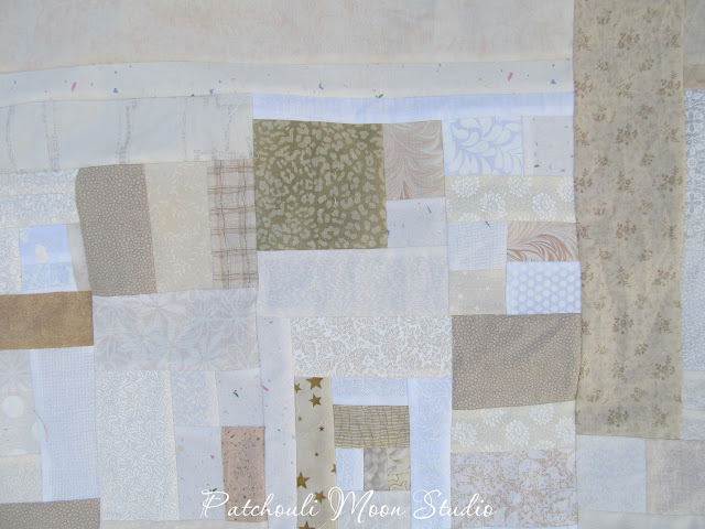 Scrappy pieced background fabric for table runner in white and off white fabrics