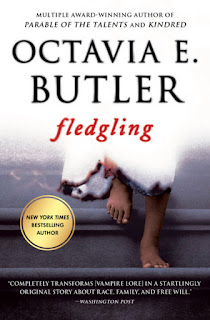 A knee-down view of a Black child in a simple white dress with a bloody hem walks down stairs, one foot up in midstep.