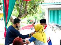 Emak-Emak Berjilbab Kuning ini Serukan Coblos No. 1 Nanang - Pandu