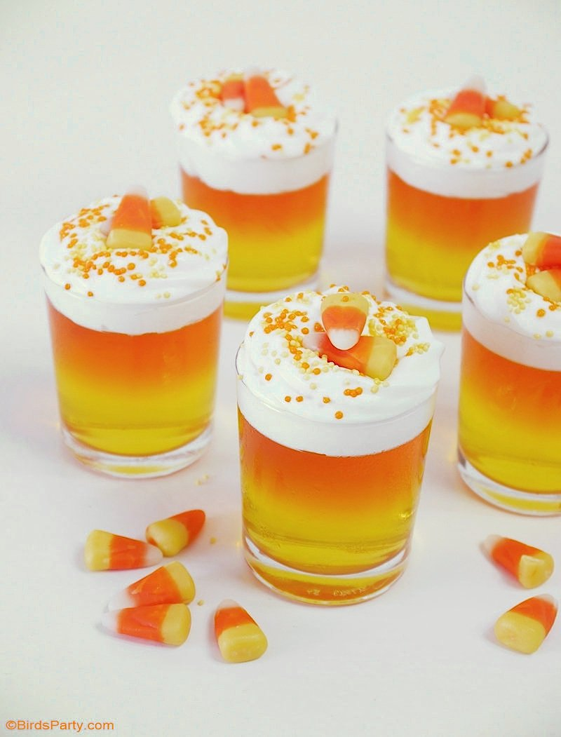 Halloween Candy Corn Jello Cups - a pretty, quick and easy to make and inexpensive dessert recipe to serve at your Halloween party! by BirdsParty.com @birdsparty #halloween #candycorn #jello #jelloshots #jellocups #halloweenrecipes #halloweendessert #halloweenjello
