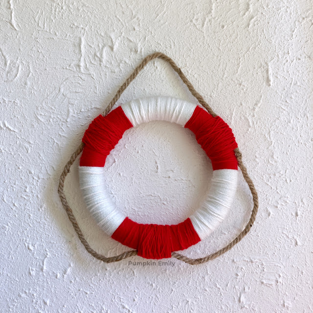 A wreath made with yarn and nautical rope.