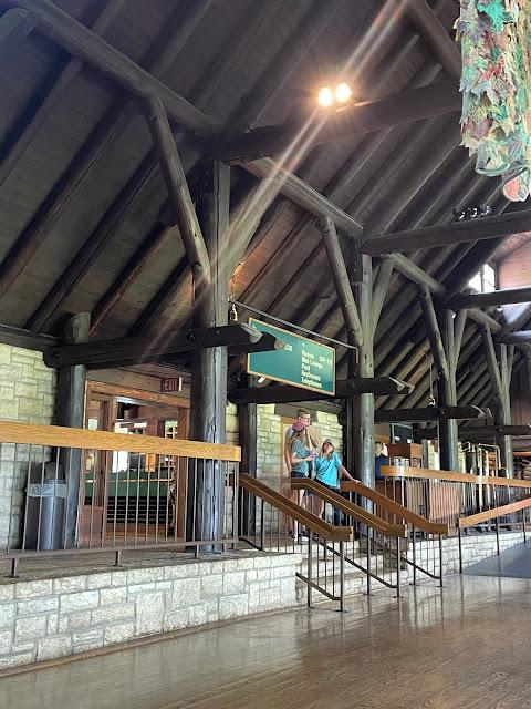 color photo of log beams inside main room of Pere Marquette lodge Grafton Illinois