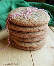 Stack of chewy maple cinnamon cookies tied up with red and white baker's twine