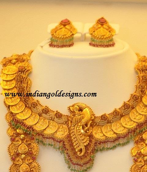 Gold and Diamond jewellery designs lakshmi devi necklace