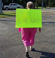 woman with car wash sign
