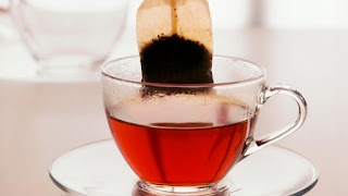 Tea and decaffeination processing