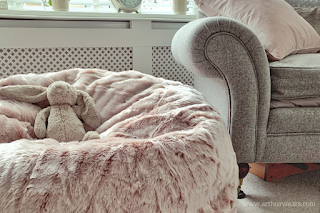 Dusky blush rose pink and grey lounge sitting room with faux g=fur beanbag