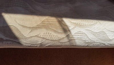 Photo of the upholstery looking discoloured due to tinted glass