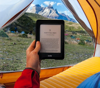 Image: Reading my Kindle in a tent on Torres del Paine. Photo by Frank Holleman on Unsplash