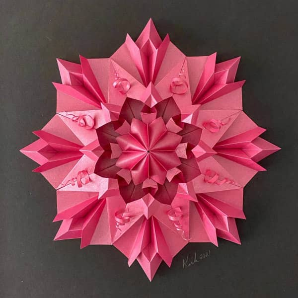 pink flower-like modular origami wall art
