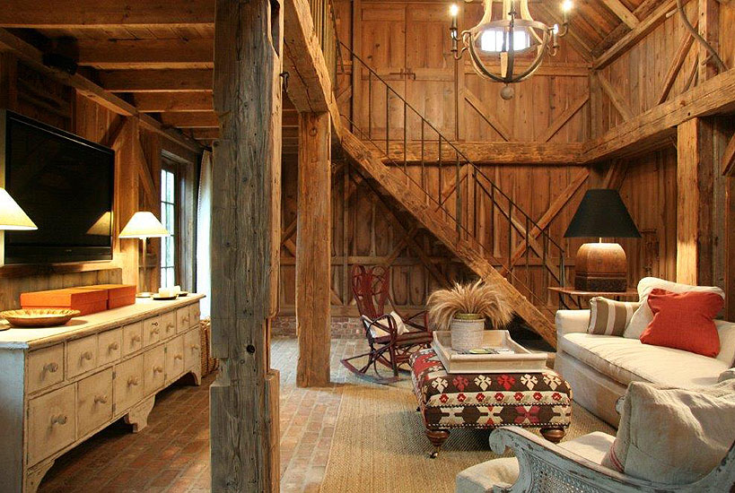 Beautiful wood walls and beams in barn conversion home by Carrier and Company