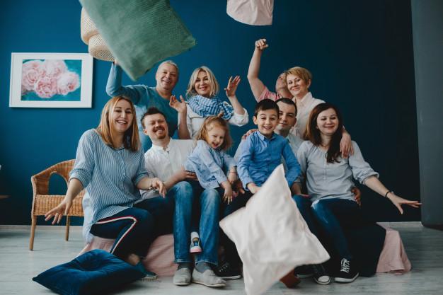 grandparents-parents-their-little-children-sit-together-bed-blue-room_8353-7682.jpg