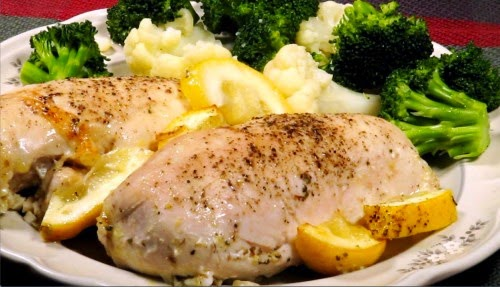 Use the back of a small spoon to press garlic and dill into other ingredients Lemony Chicken Breast recipe