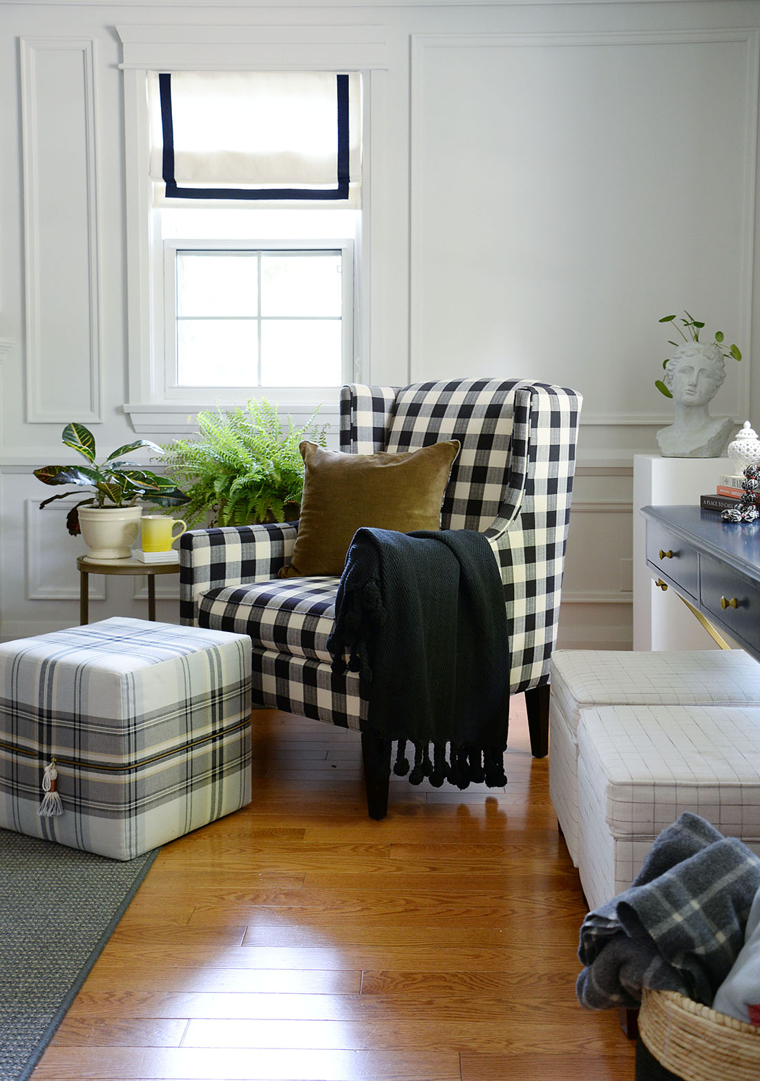 buffalo plaid chair, barrymore armchair, plaid ottoman, tonic living cube ottoman, blue desk, fern plant, Arthur velvet pillow, pom pom throw