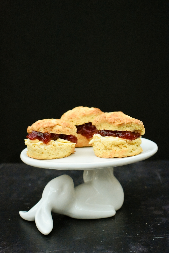 Light and fluffy Scottish scones baked to a vegan recipe and filled with dairy-free spread and jam
