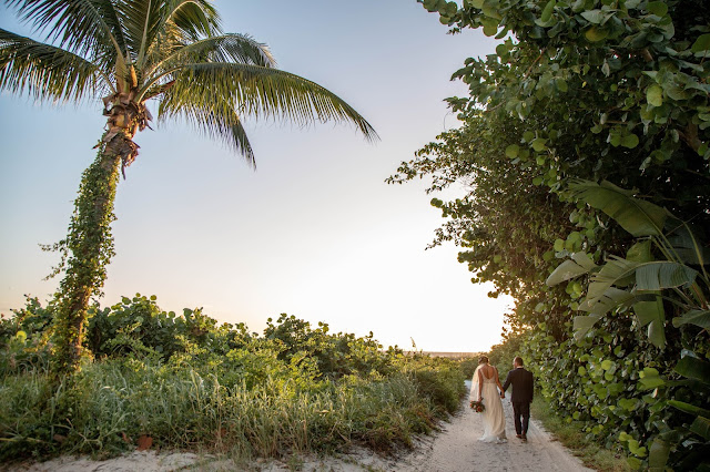 Photographs of bride and groom in tropical greenery destination.