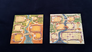 The two sides of the player mats displayed side-by-side.