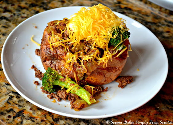 Fully Loaded Baked Potatoes filled with seasoned taco meat, broccoli, sour cream, and cheese.