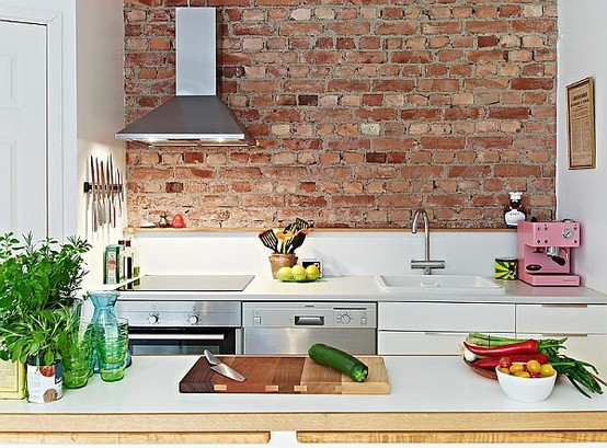 Decoração de cozinha com parede de tijolinho a vista