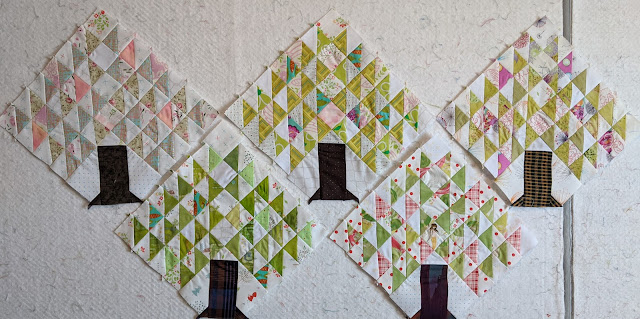The apple blossom block on the bottom row, right, is own sewn with a better arrangement of fabrics that sorts them by value on each side of the HSTs