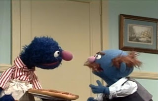 Grover and Mr Johnson Speedy Pizza. Mr Johnson orders pizza and Grover is the pizza delivery man. Sesame Street Elmo's Magic Cookbook